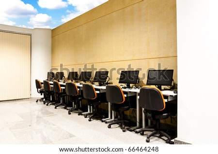 workplace room and computers in row with blue sky