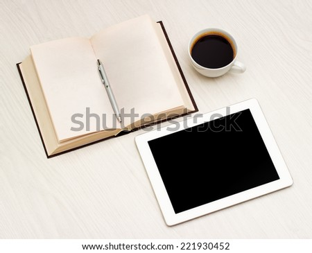 Workplace with a book, tablet and coffee