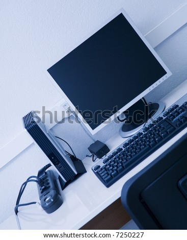 workplace with blue tint - stock photo