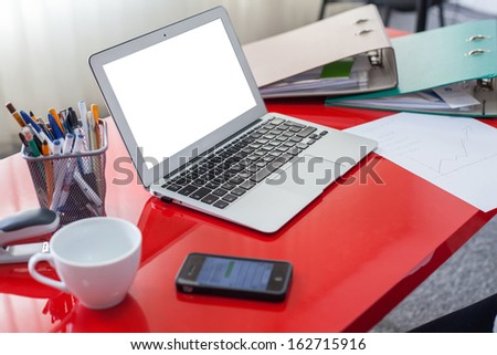 Workplace with laptop  in office. White screen, copy space. - stock photo