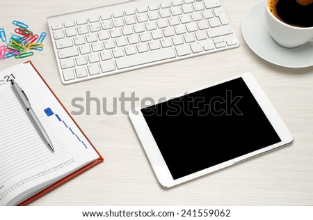 Workplace with tablet and keyboard, pen, coffee - stock photo
