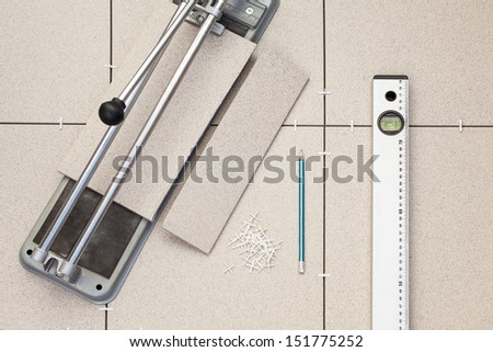 Works on laying of ceramic tiles with level - stock photo