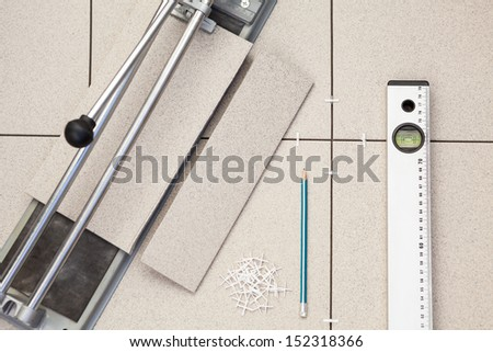 Works on laying of porcelain tiles - stock photo
