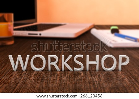 Workshop - letters on wooden desk with laptop computer and a notebook. 3d render illustration. - stock photo