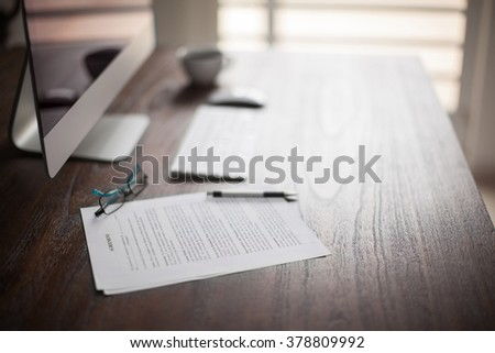 Workspace of a lawyer with some legal documents and plenty of copy space on a bright day - stock photo
