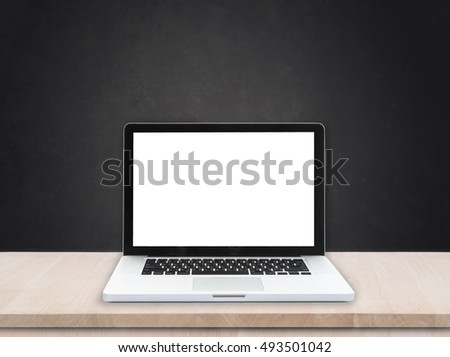 workspace with computer on desktop office and black cement background.