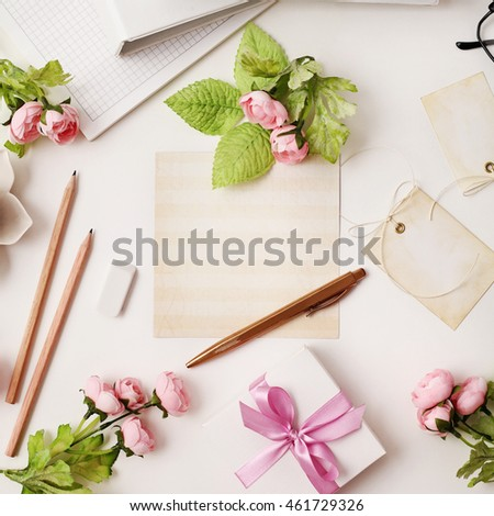 workspace with letter or greeting card on white background. Flat lay, top view office table desk.