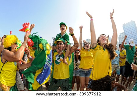 World Cup, Copacabana, Rio de Janeiro, Brazil - June 28, 2014: Brazilian supporters celebrate at the Fifa Fan Fest during the Brazil - Chile match. Score 1-1. Brazil win on penalties. - stock photo
