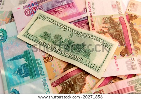 World domination of dollar. Dollar over foreign money. Close-up set of US dollars and Russian roubles