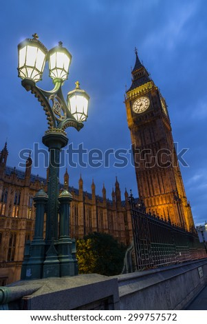 World famous clock tower of the British Houses of Parliament, nicknamed Big Ben, as seen from Westminster Bridge at night - stock photo