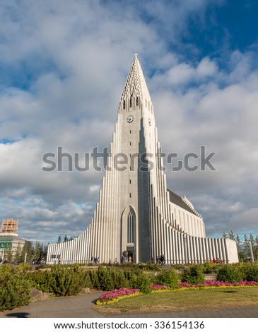 World famous Hallgrimskirkja, a lutheran cathedral in Reykjavik, shot on a slightly cloudy summer day - stock photo