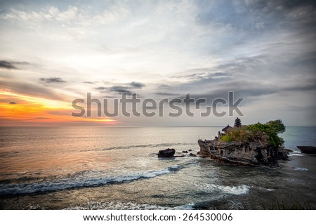 World famous Tanah Lot - or Temple of the Land in the Sea, Bali - stock photo