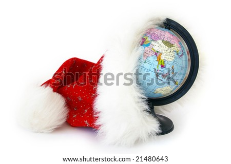 World globe and Santa Claus hat on white - stock photo
