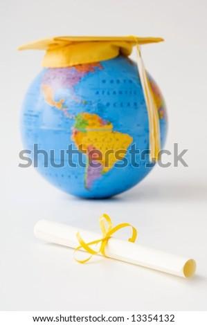 World globe diploma cap and tassel - stock photo