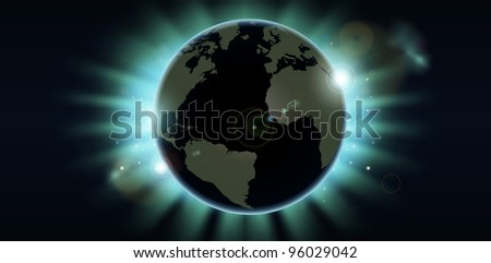 World globe eclipsing the sun directly behind it. - stock photo