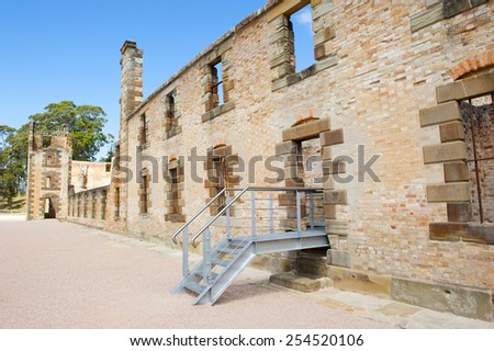 World Heritage Site of  Port Arthur Convict Museum Settlement in Tasmania, Australia, with relict of historic prison building, tourist attraction, blue sky. - stock photo