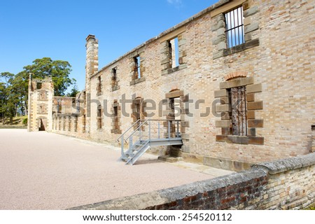 World Heritage Site of  Port Arthur Convict Museum Settlement in Tasmania, Australia, with ruin of historic prison building, tourist attraction, blue sky, copy space - stock photo