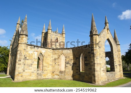 World Heritage Site of  Port Arthur Convict Museum Settlement in Tasmania, Australia, with ruins of historic church building, tourist attraction and destination. - stock photo