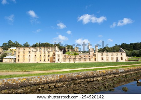 World Heritage Site of  Port Arthur Convict Museum Settlement in Tasmania, Australia, with ruins of historic prison and other buildings, blue sky, copy space. - stock photo