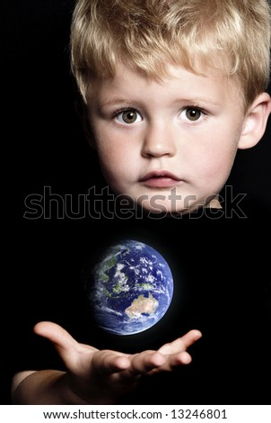 World in a child's hand - stock photo