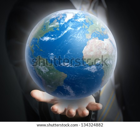 World in a hand close up. Elements of this image furnished by NASA - stock photo