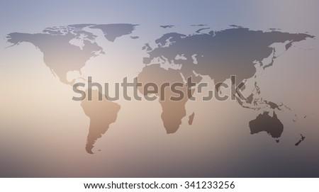 World map atlas against retro vintage blurred sky backgrounds.blurred sunrise backgrounds.blurred shining backgrounds concept.vintage colored tone. - stock photo
