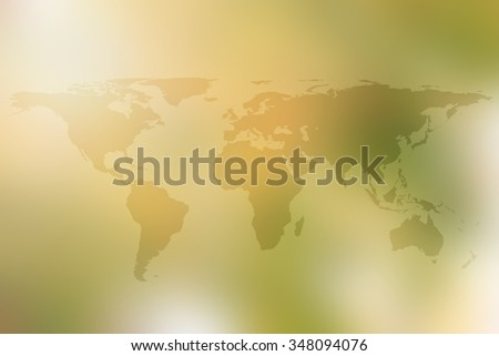 World map atlas global colorful yellow warm tone blurred background.blur abundance fertile forest shining sunrise backdrop wallpaper.environment friendly preserve concept:world nature conservation day - stock photo
