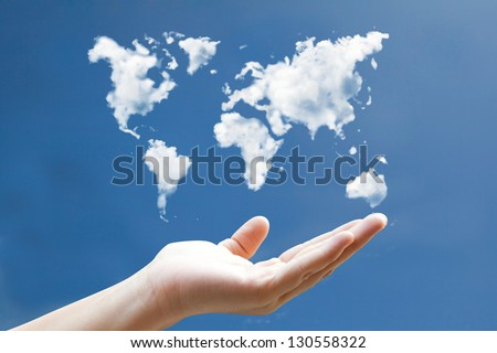 world map cloud shape floating on hand - stock photo