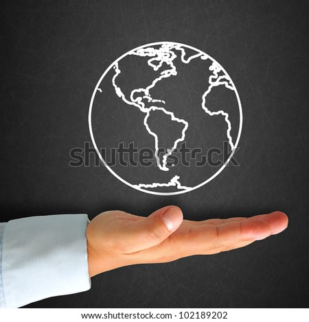 World map in blackboard with hand - stock photo