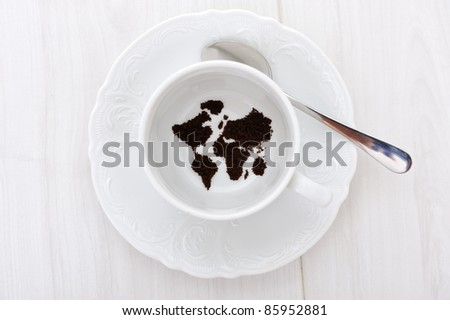 World map in coffee cup - stock photo