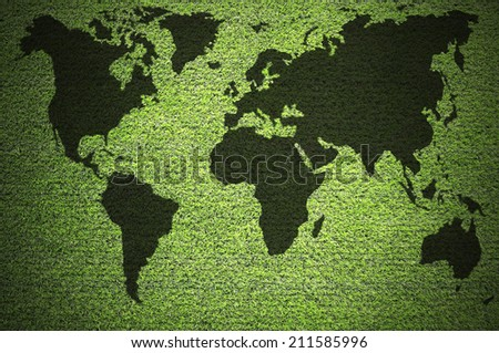 World map in green grass.