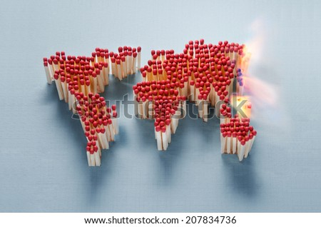 World map made of matches waiting for a spark - stock photo