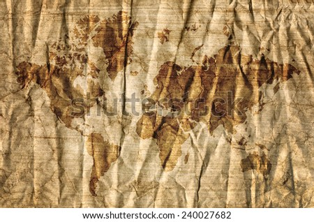 World map on aged paper texture background. - stock photo