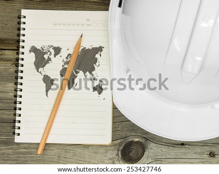 World Map on notebook over wood background - stock photo