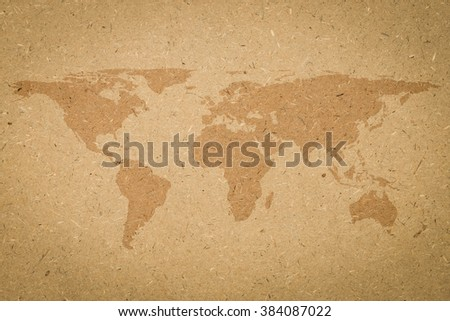 World map on tan texture board background vignette.wooden cork board beige brown cream color backdrop:silhouette planet earth screen wallpaper:retro antique board banner template.vintage effect tone. - stock photo