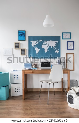 World map on the wall in teen room - stock photo