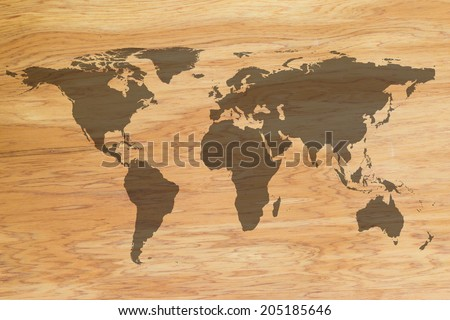 World map on wooden texture background - stock photo