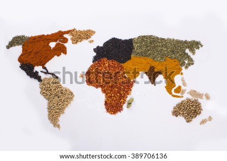 world map with spices and herbs - stock photo