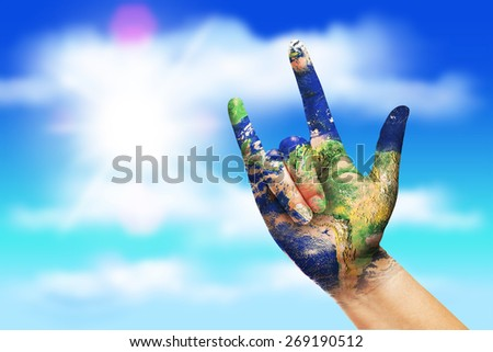 World Paint on Hand sign love on sky .clipping path  - stock photo