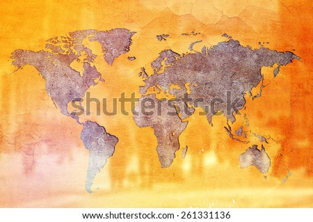 World Population Concept, Earth shaped crack in Yellow wall and silhouettes of people. - stock photo