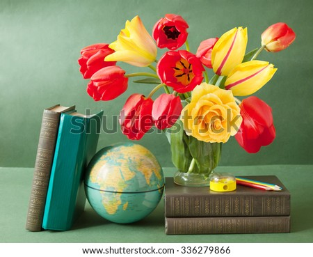 World Teacher's Day (still life with tulips and roses bunch, book pile, globe and pencil on artistic background) - stock photo