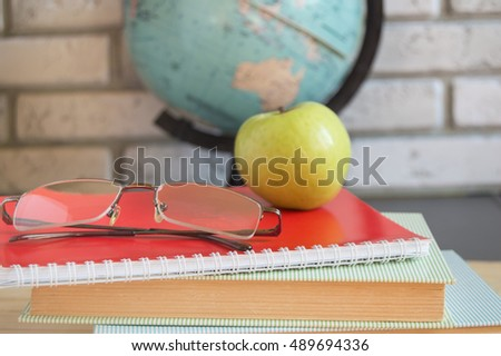 World teachers ' Day in school. Still life with books, globe, Apple, glasses selective focus