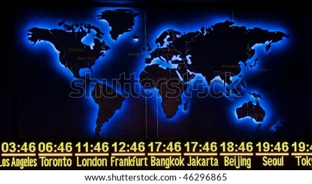 World Time display with Map in Night Version - stock photo