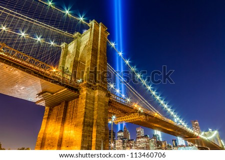 World Trade Center Lights over Brooklyn Bridge - 911 beams over Brooklyn Bridge at night - stock photo