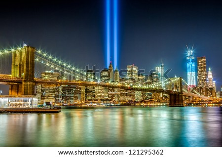 World Trade Center Tribute in Light as seen at night from Brooklyn across the East River on September 11, 2012. - stock photo