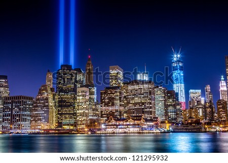 World Trade Center Tribute in Light at night from Brooklyn across the East River shot on September 11, 2012. - stock photo