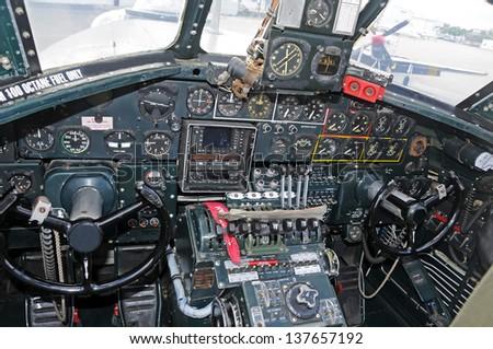 World War 2 era bomber cockpit interior view - stock photo