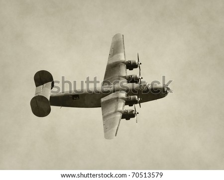 World War II era American bomber in flight - stock photo