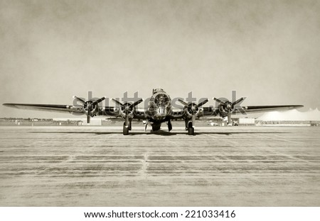 World War II era heavy bomber front view stained old photo - stock photo