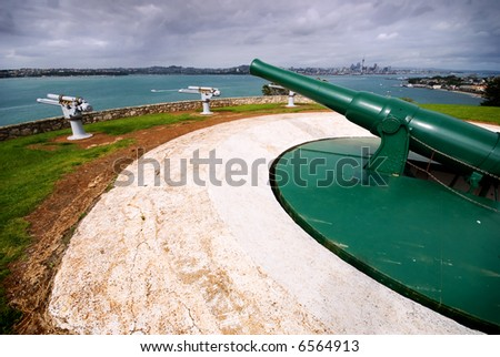 World War II guns pointing out to sea - Auckland, New Zealand - stock photo